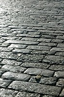 China, Yunnan Province, Lijiang, Old Town, Old Town stone walkway detail with dramatic light
