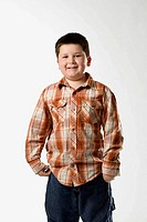 Young chubby caucasian boy photographed in studio white background Denver, Colorado, USA