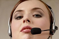 Young woman with headset, call center, telephone operator