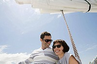 Smiling couple on a sailing boat