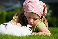 A girl stroking a rabbit