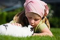 A girl stroking a rabbit