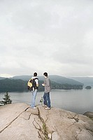 Couple on rock by lake