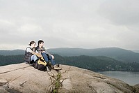 Couple on a rock by lake