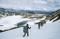 Group of hikers in the snow, Chilkoot Trail / Pass, Crater Lake, British Columbia, Canada