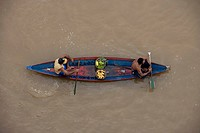 Amazonian Indians in a canoe on the Amazon River, Rio do Cajari, Para, Brazil, South America