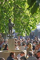 People and a fountain at beer garden at the Viktualienmarkt, Munich, Bavaria, Germany