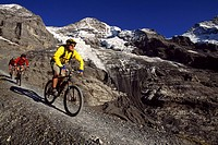 Mountain bikers, Moench, Eiger Glacier, Little Scheidegg, Grindelwald, Bernese Oberland, Switzerland