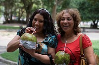Two Brazilian women sipping chilled coconut water, Belem, Para, Brazil, South America