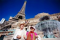 Old couple in front of Hotel and Casino Paris, Las Vegas, Nevada, USA, America