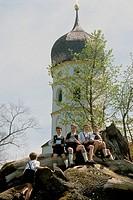 Five boys wearing lederhosen sitting outside a church, Holzhausen, Lake Starnberg, Upper Bavaria, Bavaria, Germany