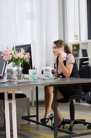 Businesswoman Sitting at Desk
