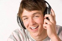 Teenage Boy Listening To Music On Headphones
