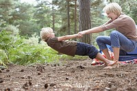 Mother and son playing in woods