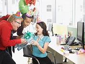 Businessmen giving birthday gift to co_worker