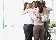 Businesspeople in huddle in office