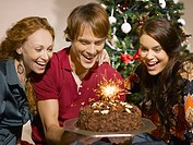 Friends looking at birthday cake