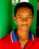 portrait of a young boy in the dominican republic with amazing bright eyes
