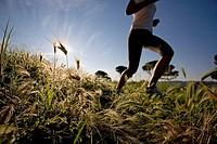 Girl jogging in countryside