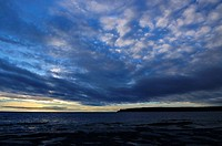 First light fanned clouds before sunrise on Georgian Bay