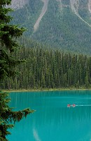 Canoeing on a pristine lake, Canadian Rocky Mountains (thumbnail)