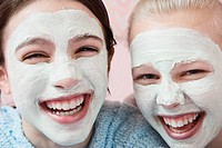 Girls with facial treatment laughing