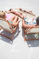 Family sunbathing on beach