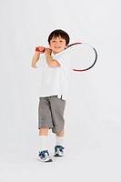Child posing with badminton racket