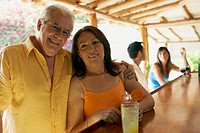 Hispanic couple drinking in bar