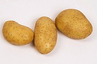 Close_up of three raw potatoes