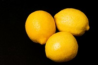 Close_up of three lemons