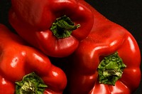 Close_up of three red bell peppers
