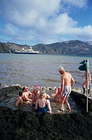 Tourists bathing in warm volcanic waters, Deception Island, South Shetland Islands, Antarctica, Polar Regions