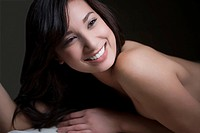 Close_up of a young woman lying on a massage table and smiling