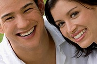Portrait of a young couple smiling together
