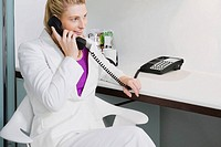 Businesswoman talking on the telephone and smiling