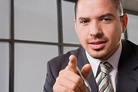 Portrait of a businessman gesturing