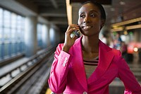 Close-up of a young woman talking on a mobile phone at a subway station (thumbnail)