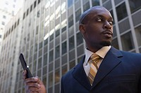 Low angle view of a businessman using a mobile phone