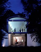 The Tall House Exterior at dusk _. Architect: Terry Pawson Architects. Engineer: Barton Engineers. Set on a long narrow site overlooking the leafy sub...