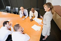 Businesswoman giving a presentation in a board room