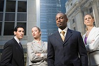 Two businessmen standing with two businesswomen (thumbnail)