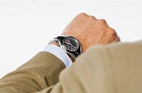 Close_up of a businessman checking the time