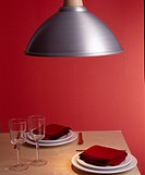 Contemporary Red Interior with Dining Table and Lamp
