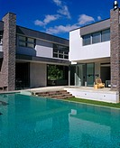 See Through Residence, Auckland. Exterior with swimming pool. Architect: Daniel Marshall Architect