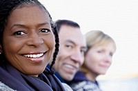 Close_up of a senior woman smiling with her friends