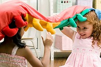 Two girls playing with a stuffed toy (thumbnail)