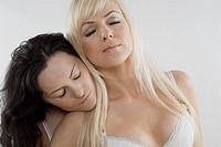 Close_up of a female homosexual couple with their eyes closed