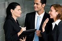 Close_up of a businessman and two businesswomen having a discussion