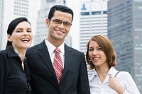 Portrait of a businessman and two businesswomen smiling